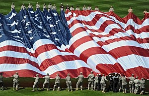 Soldiers Unfurl US Flag