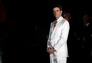 Rick Pitino in white suit